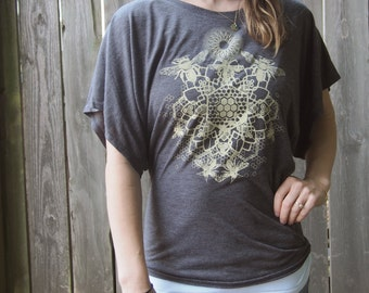 Bee Mandala on a Charcoal Flowy Dolman Sleeve Fashion T-shirt printed in Honey Cream
