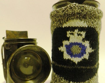 Hand-knitted British Bobby cafetiere/french press hug