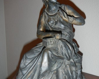 Vintage bronze statue of Victorian woman holding jewelry box