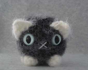 Crocheted grey and white plush kitty