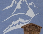 snowcapped tee - ice blue - mountains and rolling hills with a cozy chalet applique