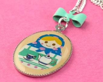 Matryoshka Tea Necklace - Kawaii Nesting Doll Pendant with Bow - Yellow & Mint Green