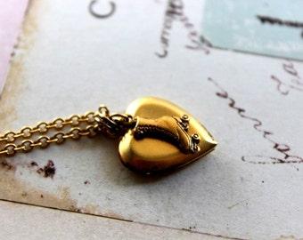 roller skate. locket necklace. gold ox