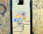 "Luggage Tag with Picasso's ""Hands with Bouquet."""