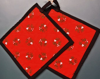 Larger thicker Christmas color quilted pair of potholders made of cotton fabric