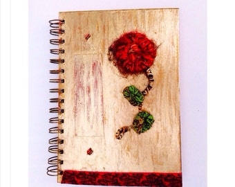 Red and gold spiral notebook with poppy, journal