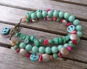 Sale: Peace stone beaded multistrand bracelet