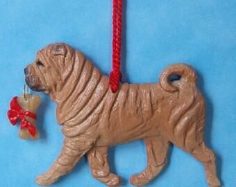 Shar Pei with bone, fawn. Dog breed sculpted artist ornament.