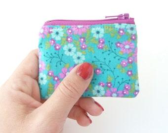 cute teal coin purse zipper pouch. pink aqua floral fabric jewelry case small gift idea. pill ear bud hearing aid pouch