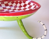 big serving bowl :) red & white checkered on long curly beetlejuice legs