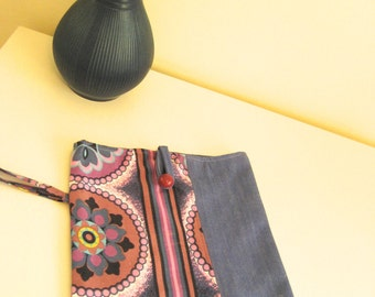 Purple, blue, white retro floral print iPad sleeve paired with brushed denim and brushed denim lining