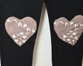 Black leggings with bird hearts