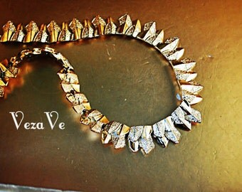 Art deco style vintage 70s  silvertone textured metal with a bronze shade collar choker necklace. Made by Coro.Mint condition.