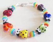 Bright Rainbow Ladybug Bracelet Lampwork Sterling Silver Bracelet by keiara SRA