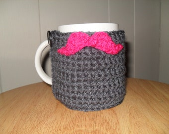 crocheted mustache cup cozy mug cozy on smoky gray with hot pink mustache