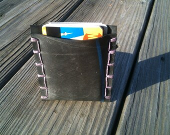 Upcycled rubber tire business card holder with blue stripe and lavender hemp stitching.