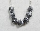 Silver glitter resin sparkle geometric bead necklace.