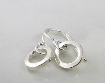 Sterling silver, tiny Orbit little earrings. Simple, minimalist hoops. Light, short and dainty earrings