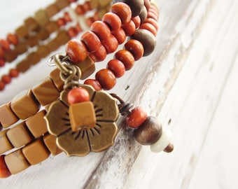 Beaded Memory Wire Bracelet featuring Tropical Rust, Brown, Yellow and White Wood Beads and Flower Charm