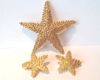 Vintage 80s  heavily textured gold starfish demi parue brooch and earrings set
