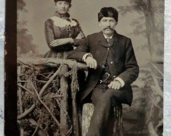 Tintype Photo Man and Woman Wearing Hats Posing Wooden Gate