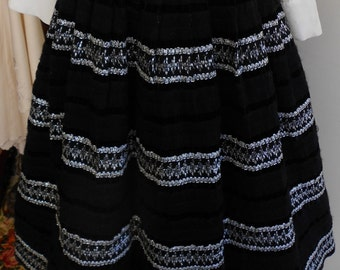"1950's, 28""-30"" waist, black wool circle skirt,"
