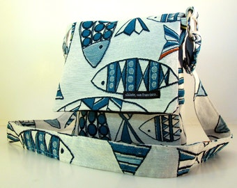 "Hip Bag in ""Fish"". Blue and white bag. Travel Bag.  Adjustable strap. Cross Body. Washable. Black ballistic nylon lining. Made in USA."