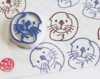 baby sea otter hand carved rubber stamp. marine animal stamp. diy baby shower. birthday scrapbooking. gift wrapping. stamps by talktothesun