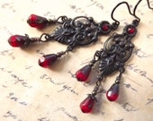 Vintage inspired chandelier earrings with red glass drops, Victorian style, blackened brass