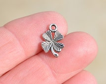 10  Silver 4 Leaf Clover Charms SC1140