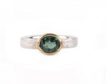 structured silver ring with green tourmaline