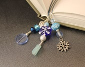 Winter Wonderland Leather Corded Three Strand Book Mark In Ice Blues, Snowflakes, Glass Beads and Silver Tone Beads