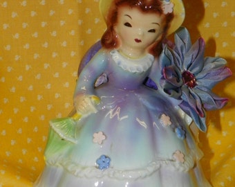 Vintage Doll Planter upcycled to a pincushion. with hand made stick pin.