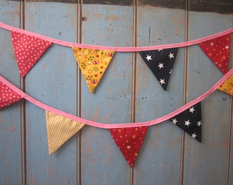 Children's  Bunting. Colours - Yellow, Dark Coral, Navy, Pink and Red. Patterns -  Gingham, Bows, Butterflies and Stars.. 3m long.