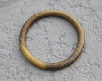 Rounded bamboo bangle bracelet.