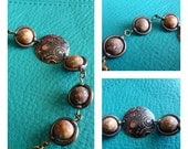 Chemically Etched Gear Focal Pendant with S'more beads and Copper Frames Bracelet