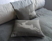 hand printed muted grey hare pair cushion