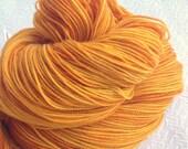 hand dyed Poseidon's Trident Super Shawl Length Skein Superwash Merino Cashmere Nylon MCN 600 yards fingering weight orange goldenrod