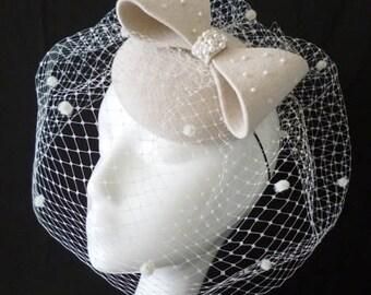 Cream felt bow button with birdcage veil