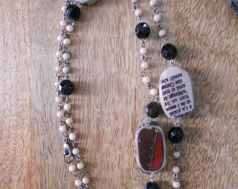 Black and cream with a bit of red text necklace