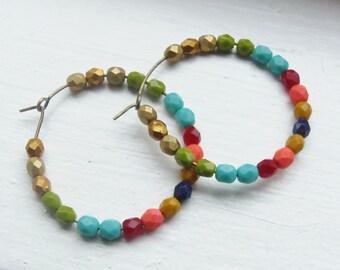 Colorful beaded hoop earrings.coral. turquoise. green. red. navy. mustard. gold. bronze. hoops. beaded hoops. beaded earrings.