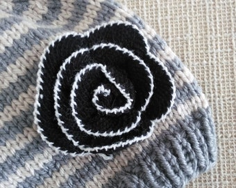 Striped beanie with yarn rose.