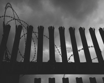 Black and White Industrial Fine Art Photograph - Razor Wire Fencing Against Dark Sky - Limited Edition Print in Various Sizes, Finishes