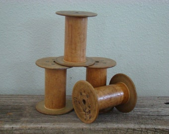 Set of 4- ANTIQUE WOOD SPOOLS- Natural color ends--Nice spools....nice smaller size 3 3/4""