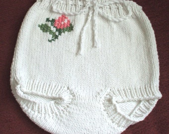 Hand knit white 50 percent cotton 50 percent  acrylic pants or diaper cover with drawstring and embroidered rose