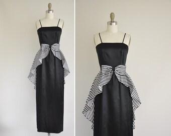 60s dress / 1960s vintage dress / black and white satin peplum party dress