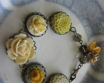 Butterscotch.vintage and flower assemblage bracelet
