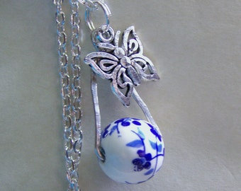 Ceramic Blue Floral Bead with Silver Butterfly Pendant