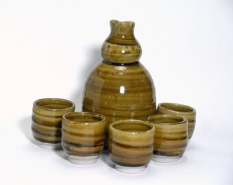 Sake set with amber tea dust glaze and 5 cups