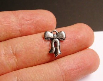 Bow charms - 24 pcs - hypoallergenic - antiqued silver bow charms -  ASA5